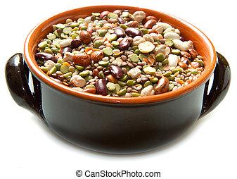 vegetables in crock pot on white background