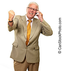 Senior Business Man Using Phone Cheering Isolated On White...