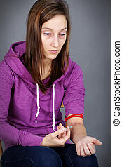 Young woman injecting drugs - Young woman junkie, getting...