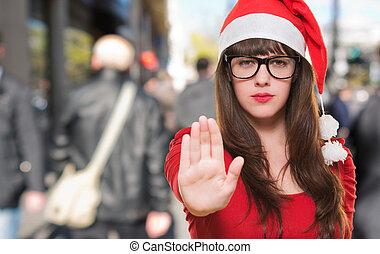 mujer, parada, navidad, gesto