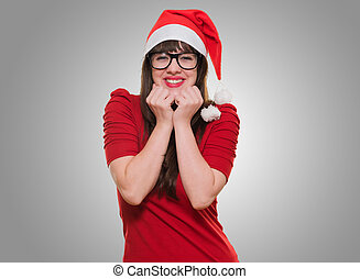 excited christmas woman wearing glasses against a grey...