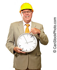 Portrait Of A Senior Man Holding A Wall Watch On White...