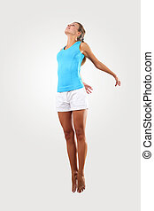fitness woman jumping excited - bright picture of happy...
