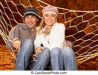 Two loving people in hammock - Picture of two loving person...