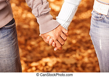 People holding each other by hands - Photo of two loving...