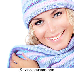 Happy girl in winter hat, beautiful young female wearing...