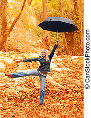 Sweet girl jumping with umbrella - Picture of sweet girl...