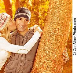 Happy couple in autumn park