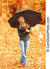 Pretty woman under umbrella - Picture of pretty woman...
