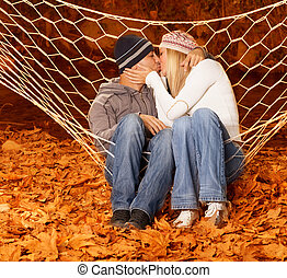 Loving pair kissing in hammock - Picture of loving pair...