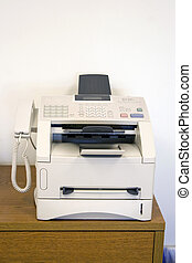 Fax Machine - A fax machine sitting on a table in the office...
