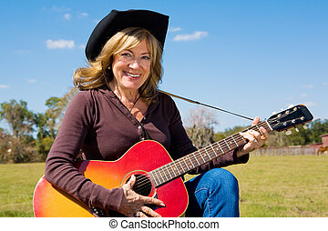 Country Music Cowgirl - Beautiful mature cowgirl plays...
