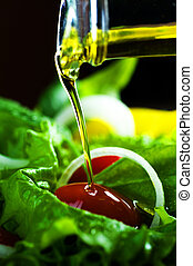 Healthy Salad And Pouring Olive Oil