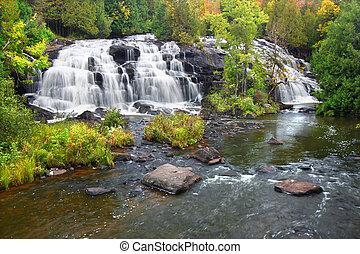 Bond Falls Scenic Area on an autumn day in the northwoods of...