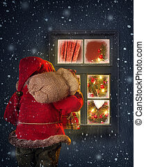 Santa Claus looking through a window - Santa Claus looking...