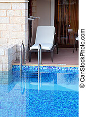 hotel rooms and swimming pool - exit out of hotel rooms in...