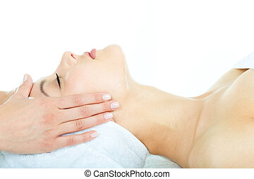 Facial massage - Beautiful woman is getting a facial massage...