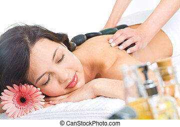 Spa - Photo of young naked woman getting a stone massage in...