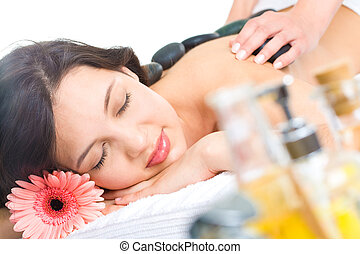 Day spa - Pretty woman enjoys massage in the spa salon