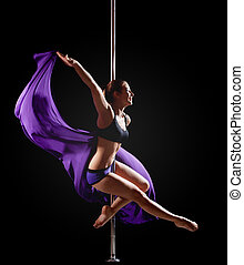 girl show gymnastic exercise with pole dance - Beauty girl...