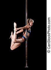 Blond woman during pole dance show exercise