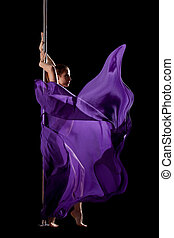 Woman posing in pole dance with fabric isolated - Beauty...