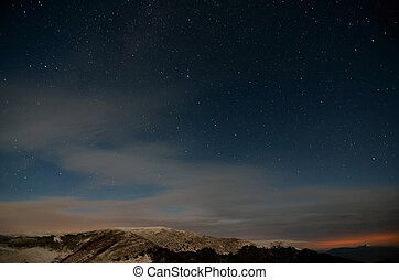 Amazing Star Night. Starry cloudy sky in the mountains