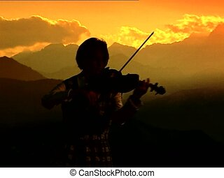 Violinist silhouette at sunset MS - Violinist female...