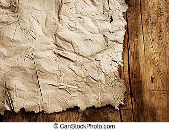 Old Paper sheet over wooden background closeup