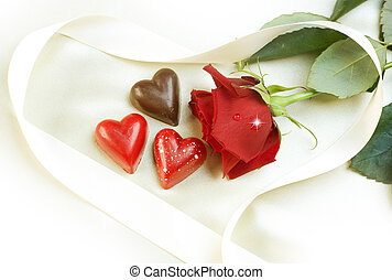 Valentine card. Chocolate hearts and red rose