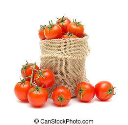 cherry tomatoes in a canvas bag on a white background - ripe...