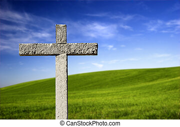 Religious cross in the paradise - Religious stone cross on a...