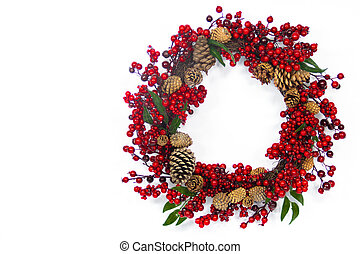 Red Berry and Pine Cone Wreath - A brown twig wreath is...