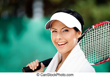 Tennis player with towel on her shoulders Active pastime