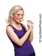 Pretty woman with lollypop - Woman in heart shaped glasses...