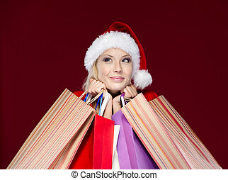 Woman in Christmas cap hands packets