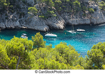 Moored boats in the Calanques of Port Pin in Cassis - Moored...