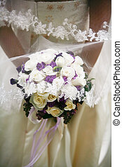 Bridal Bouquet - Brides hands holding a bouquet