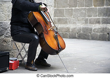 Busker - Shot of a busker playing the cello.
