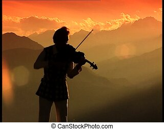 Violinist silouhette at sunset knee