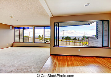 Apartment living room with large windows - Apartment living...