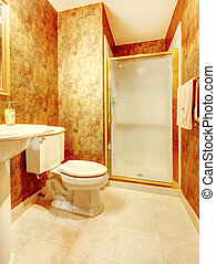 Golden antique bathroom with shower and marble tiles.