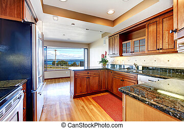 Apartment kitchen with water view and granite.