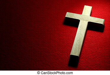 Crucifix on Red - Closeup of wood crucifix on red felt...