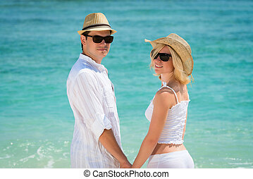 Young couple enjoying their holiday on the beach