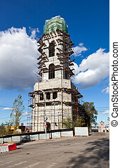 Tower monastery under construction over blue sky background in Samara, Russia