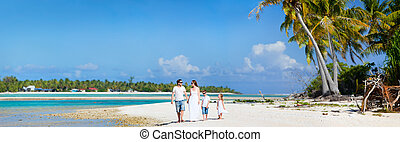 Family on beach vacation - Panoramic photo of beautiful...