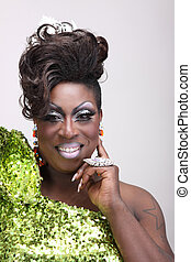 Drag queen wearing a green gown with sequins
