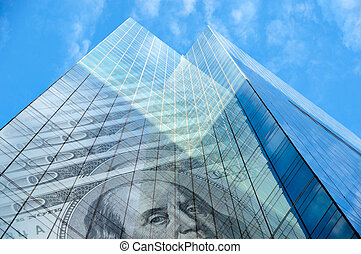 Office building with hundred dollar bills on blue sky with...