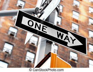 "One way sign - ""one way"" sign on pole in street in u.s.a."